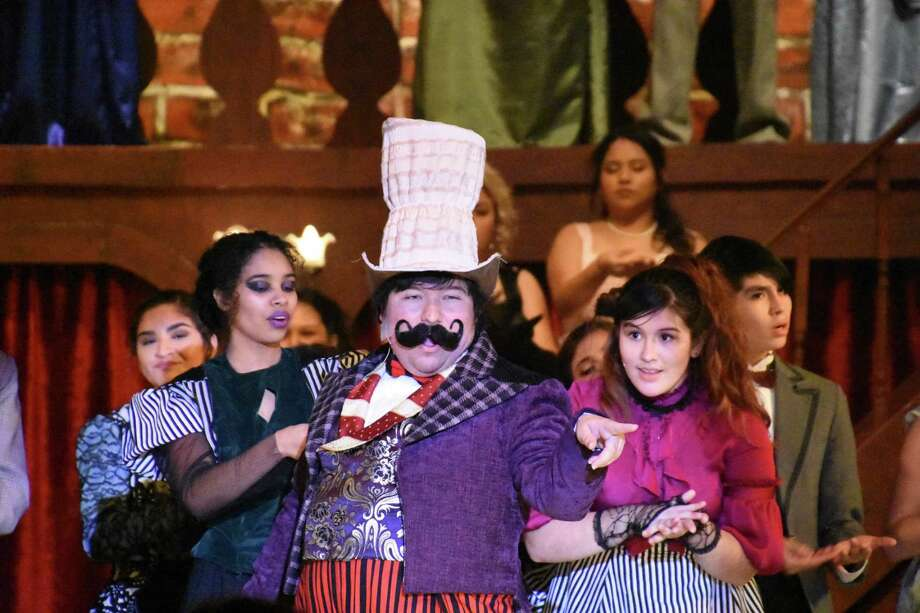 "Matthew Linares performs with ensemble members Olga Duran, left, and Amber Cardenas in South Houston High School's production of ""The Mystery of Edwin Drood,"" which received three Tommy Tune award nominations."