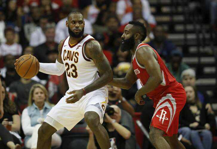 HOUSTON, TX - NOVEMBER 09:  LeBron James #23 of the Cleveland Cavaliers controls the ball against James Harden #13 of the Houston Rockets in the first half at Toyota Center on November 09, 2017 in Houston, Texas.  NOTE TO USER: User expressly acknowledges and agrees that, by downloading and or using this photograph, User is consenting to the terms and conditions of the Getty Images License Agreement.  (Photo by Tim Warner/Getty Images)