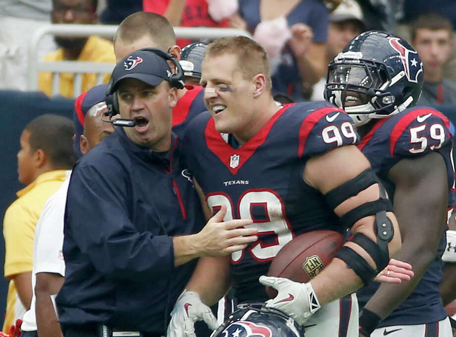 HOUSTON, TX- SEPTEMBER 28: J.J. Watt #99 celebrates with head coach Bill O'Brien of the Houston Texans  after returning an interception for a 80 yard touchdown against the Buffalo Bills inn the third quarter in a NFL game on September 28, 2014 at NRG Stadium in Houston, Texas. (Photo by Scott Halleran/Getty Images) Photo: Scott Halleran/Getty Images