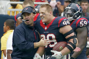 HOUSTON, TX- SEPTEMBER 28: J.J. Watt #99 celebrates with head coach Bill O'Brien of the Houston Texans  after returning an interception for a 80 yard touchdown against the Buffalo Bills inn the third quarter in a NFL game on September 28, 2014 at NRG Stadium in Houston, Texas. (Photo by Scott Halleran/Getty Images)