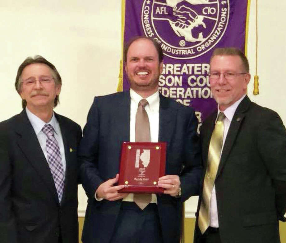 Labor leaders Rick Stamer, left, and Don Webb with Randy Gori, center, after he received the 2018 Friend of Labor Award. Photo: For The Intelligencer