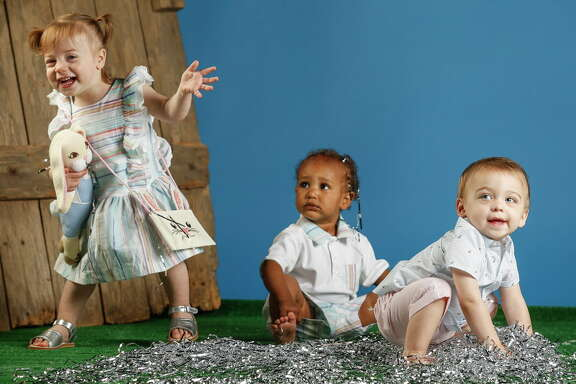 Selma Rose, Axl Moore and Rowan Carroll model Easter fashion from Itsy Bitsy Boutique. Monday, March 19, 2018 in Houston. (Michael Ciaglo / Houston Chronicle)