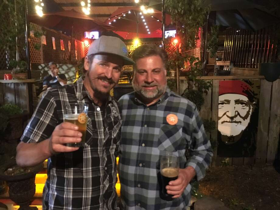 Coloradoans Jimmy Walker, left, and Todd Thibault of Breckenbridge Brewery at the Mucky Duck during a trip to Houston, March 2018. Photo: Ronnie Crocker