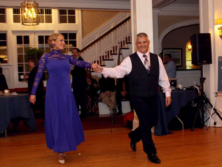 "The Bridgeport Hospital Auxiliary will host its annual spring gala, ""Dancing  with the Hospital Stars,"" from 6 to 10 p.m. Friday, April 27, 2018, at Brooklawn  Country Club in Fairfield. Pictured -- last year's dance contest winner Paul Possenti (right), Bridgeport Hospital director of Trauma, Security, Emergency Preparedness and Emergency Medical Services, with his professional partner Monika. Photo: Contributed / Bridgeport Hospital"