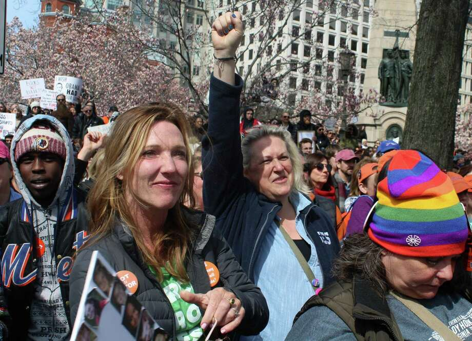 Westport residents Darcy Hicks and Jeanne Bowles react to speeches at the March for Our Lives demonstration in Washington D.C. on March 24. Photo: Sophie Vaughan / Hearst Connecticut Media / Fairfield Citizen
