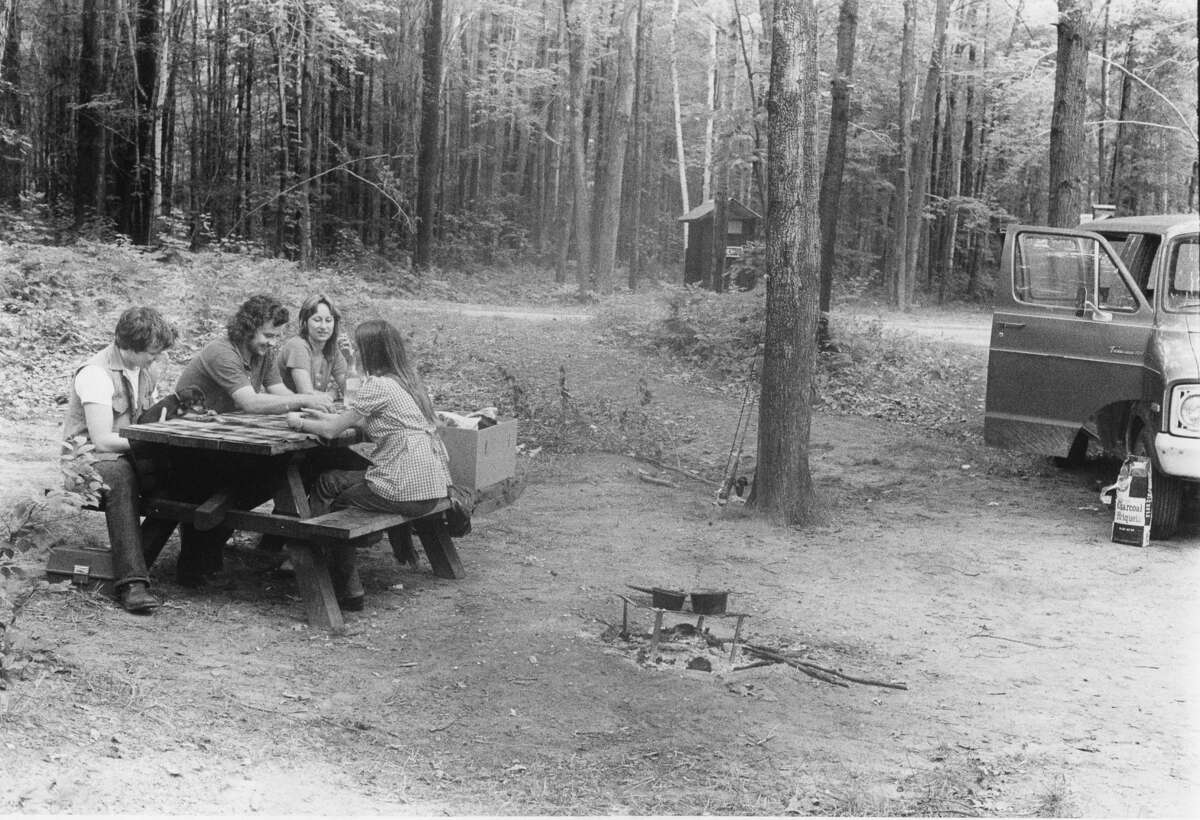 From left, Randy Gillette, Bob Gillette, Garnet (Hatfield) Gillette and Liz Gillette (back to camera) take in a weekend of camping at Black Creek campgrounds. August 1975