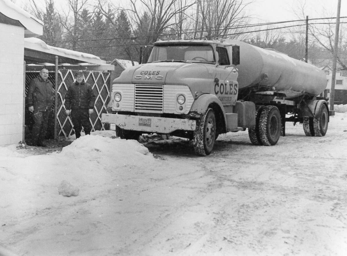 Robert Meyer and Allen J. Cole with Cole's water truck at the Red Oak Lounge in Sanford. Before city water, Cole's supplied about five businesses in Sanford with water. February 1971. Information from Candie (Cole) Allen