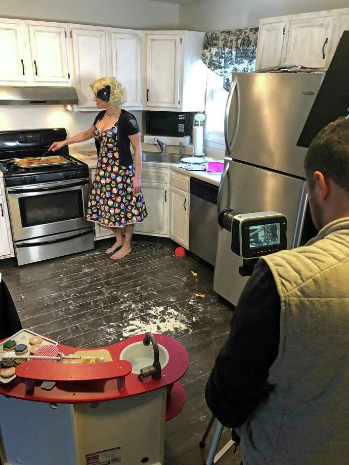 "Lorraine Toth, left, and director Bobby Chase in Toth's Clifton Park kitchen, filming the pilot episode of ""Baking with Baby."" (Provided)"