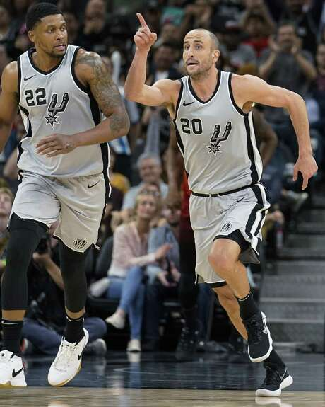 San Antonio Spurs' Manu Ginobili (20) and Rudy Gay celebrate a basket during the second half of the team's NBA basketball game against the Utah Jazz, Friday, March 23, 2018, in San Antonio. San Antonio won 124-120 in overtime. (AP Photo/Darren Abate) Photo: Darren Abate, FRE / Associated Press / FR115 AP