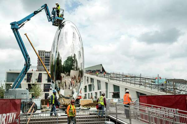 """ìCloud Column,"""" a 30-foot-high stainless-steel form by Anish Kapoor is installed outside the new Glassel School of Art building on Monday, March 26, 2018, in Houston."""