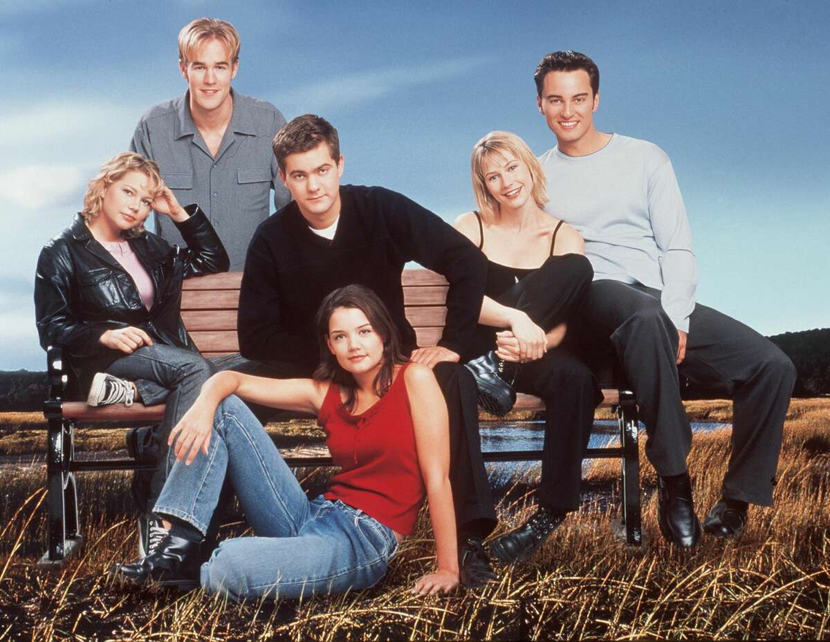 """The cast of """"Dawson's Creek."""" """"But as a graduating member of the class of 1995 and having been to four graduation ceremonies at Cheshire Academy, it can get really hot out there...You get a sunburn, a really weird sunburn too because you're wearing one of those weird hats...and it's just not a good look, and you're never going to wear that robe again. So, at least you didn't have to buy that thing,"""" he joked. Van Der Beek ended on a hopeful note reassuring seniors that """"amidst all this chaos, there is opportunity."""" His advice to the class of 2020 was """"follow your heart"""" and """"do what you love,"""" and not get too caught up in making plans. The class of 2020 did eventually have a social-distanced ceremony on July 31. Another fun fact about James Van Der Beek is that his last name actually means """"of the creek"""" in Dutch. It seems, though, that this is a complete trippy coincidence as the creator of the show originally wanted to cast Joshua Jackson, who ended up playing Pacey, as the titular character."""