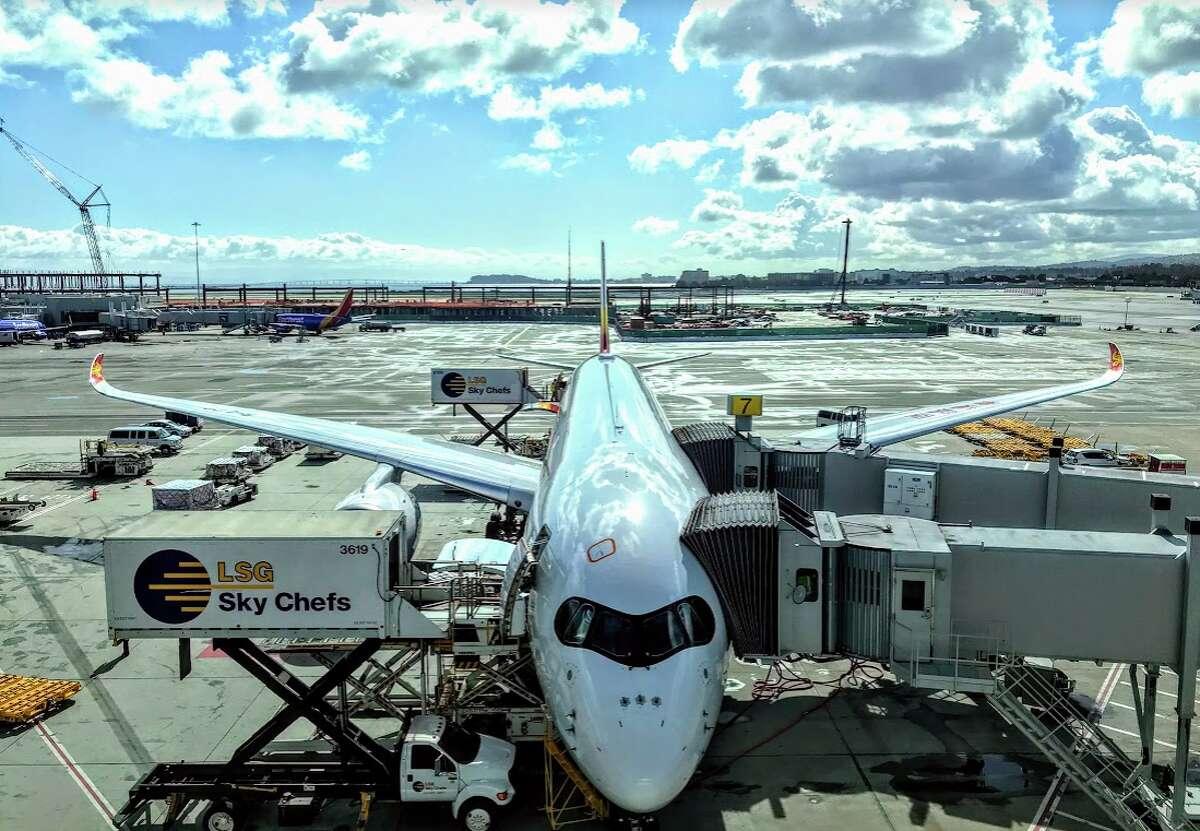Hong Kong Airlines Airbus A350 at SFO awaiting departure for Hong Kong - last flights are on Oct 4, 2019