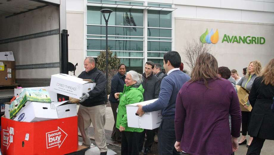 Employees of Avangrid Foundation l]help load Connecticut Food Bank truck with more than 1,000 lbs, of food they collected. In addition to employees collecting the food and $500 in cash, the foundation donated $25,000. Photo: Courtesy Of Avangrid Foundation