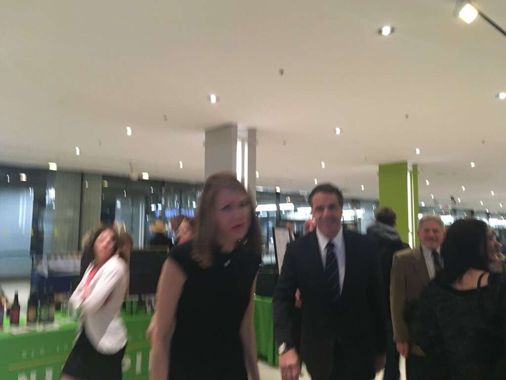 Governor Andrew Cuomo and spokeswoman Melissa DeRosa arrive at the State Police Capitol office after New York Daily News reporter Ken Lovett was detained by troopers for allegedly using a cellphone in the state Senate lobby. Photo: Rachel Silberstein