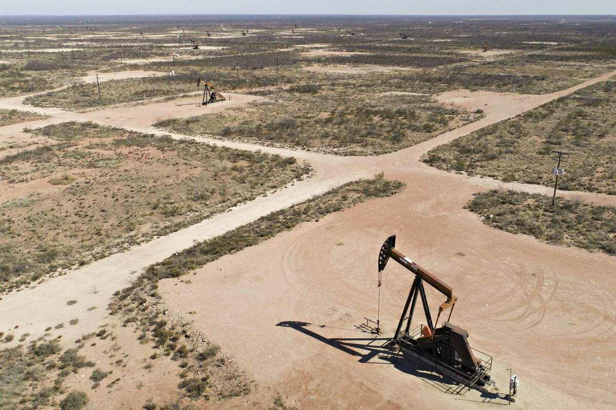 Pumpjacks operate on oil wells in the Permian Basin in this aerial photograph taken over Crane, Texas, on March 2, 2018.