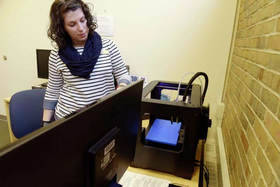Tori Russo, a public services librarian demonstrates how to use the 3D printer at the Bethlehem Public Library, on Wednesday, March 28, 2018, in Delmar, N.Y.   (Paul Buckowski/Times Union) Photo: PAUL BUCKOWSKI, Albany Times Union / (Paul Buckowski/Times Union)