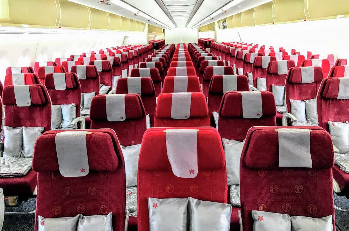 A sea of red in economy class on Hong Kong Airlines Airbus A350 now landing at SFO