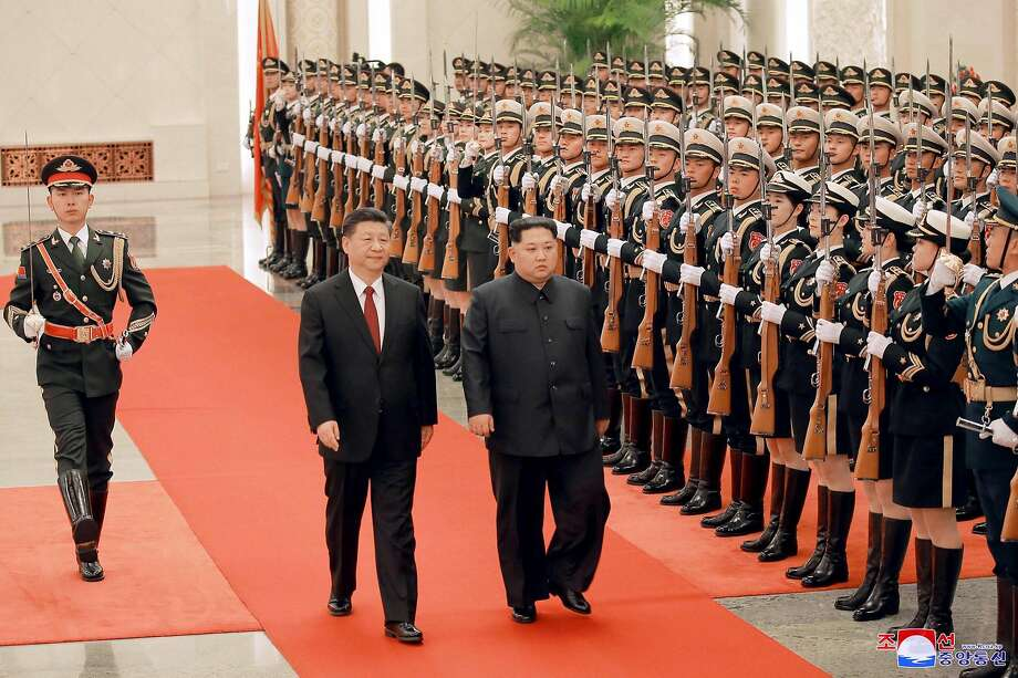 In a photo provided by North Korea's Korean Central News Agency, , President Xi Jinping of China, left, and Kim Jong-un, North Korea's enigmatic young leader, inspect an honor guard during a ceremony at the Great Hall of the People in Beijing on March 26, 2018. Kim made an unannounced visit to Beijing, meeting with Xi weeks before planned summit meetings with American and South Korean leaders, Chinese and North Korean state news media reported on Wednesday, March 28, 2018. (Korean Central News Agency via The New York Times) -- EDITORIAL USE ONLY -- Photo: KOREAN CENTRAL NEWS AGENCY, NYT