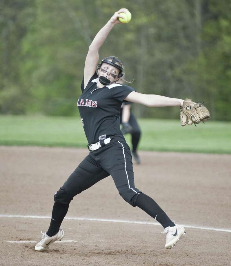 New Canaan High School pitcher Gillian Kane strides toward the plate in a game last season. Kane will be New Canaan's biggest weapon in 2018. Photo: Scott Mullin / For Hearst Connecticut Media / The News-Times Freelance