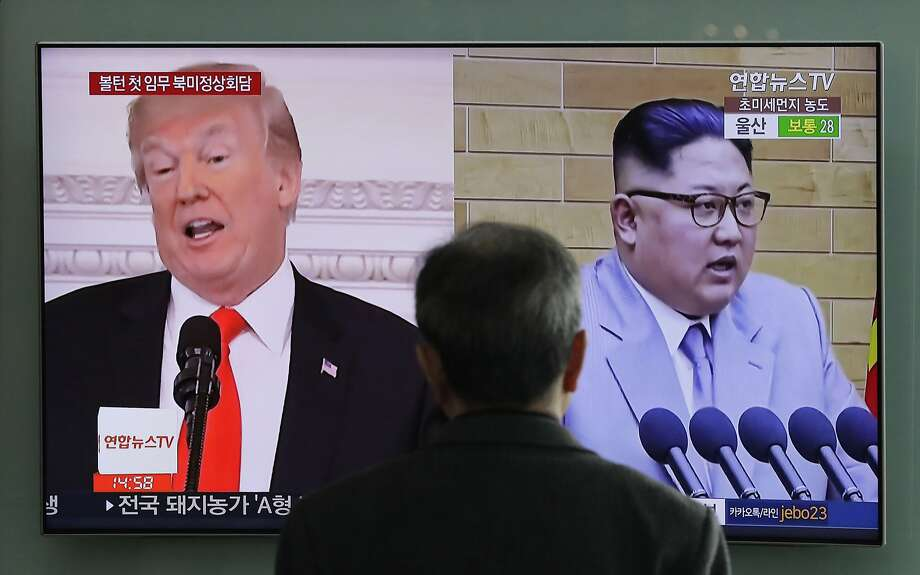FILE - In this March 27, 2018 file photo, A man watches a TV screen showing file footages of U.S. President Donald Trump, left, and North Korean leader Kim Jong Un, right, during a news program at the Seoul Railway Station in Seoul, South Korea. Increased activity at a North Korean nuclear site has once again caught the attention of analysts and renewed concerns about the complexities of denuclearization talks as President Donald Trump prepares for a summit with Kim Jong Un. (AP Photo/Lee Jin-man, File) Photo: Lee Jin-man, Associated Press