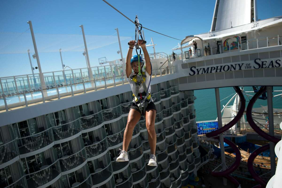 A woman slides down a zip line aboard the Royal Caribbean's Symphony of the Seas.