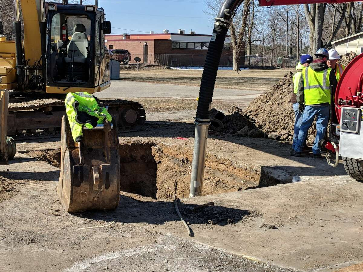 Beaverton Department of Public Works officials and Wards Excavators staff work on two area sinkholes. The deep holes on Brown and Saginaw streets are being repaired. DPW Supervisor Robert Sabisch said once filled, they will keep the areas closed, allowing the dirt and cement to pack in.