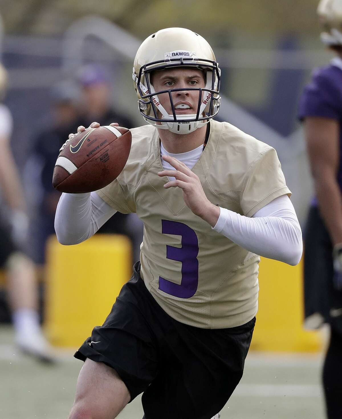 Washington quarterback Jake Browning looks to pass at the first practice of spring football for the NCAA college team Wednesday, March 28, 2018, in Seattle. As the Wall Street Journal points out, he's not the only Jake who's on Husky field. (Click through to see more alumni from UW)