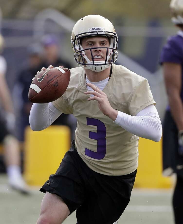 Washington quarterback Jake Browning looks to pass at the first practice of spring football for the NCAA college team Wednesday, March 28, 2018, in Seattle. As the Wall Street Journal points out, he's not the only Jake who's on Husky field. (Click through to see more alumni from UW) Photo: Elaine Thompson/AP