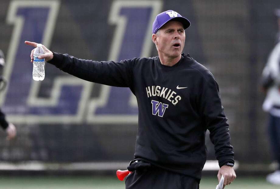 Washington head coach Chris Petersen directs his team at the first practice of spring football for the NCAA college team Wednesday, March 28, 2018, in Seattle. (AP Photo/Elaine Thompson) Photo: Elaine Thompson/AP
