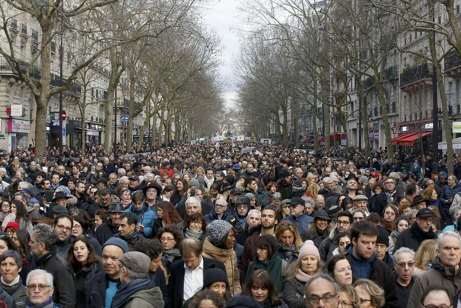 Thousands of people march down a Paris street in honor of an 85-year-old woman who escaped the Nazis 76 years ago but was slain last week in her apartment in an apparent hate crime. Photo: Thibault Camus / Associated Press