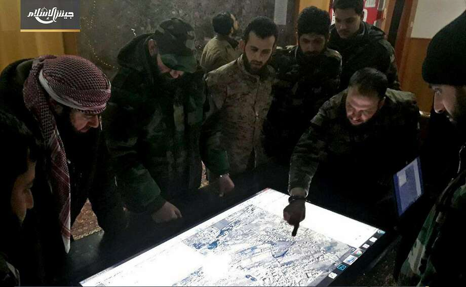 Army of Islam commanders study a military map of the eastern Ghouta suburbs of Damascus. The once-powerful rebel group has few options remaining as the Syrian army closes in. Photo: Associated Press