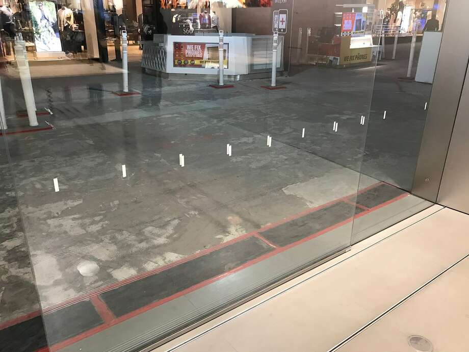 Rectangular stickers on a glass panel at an Apple store in Westfield Valley Fair mall in Santa Clara. Apple has used similar stickers, black with slightly rounded corners, at Apple Park to prevent employees from walking into glass panes, according to a Cupertino building official. Photo: Photo Provided By Albert Salvador / Photo Provided By Albert Salvador