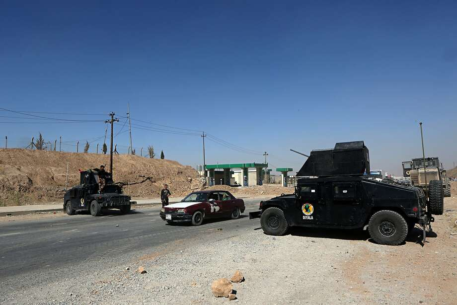 Government security forces and local police staff a checkpoint at the northern entrance to Kirkuk. Photo: Khalid Mohammed / Associated Press