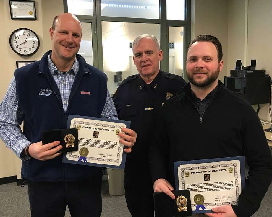 Craig Zottola, left, and Daniel Bucci, right, have become detectives in the Greenwich Police Department. Police Chief James Heavey, center, offers his congratulations. Photo: / Contributed