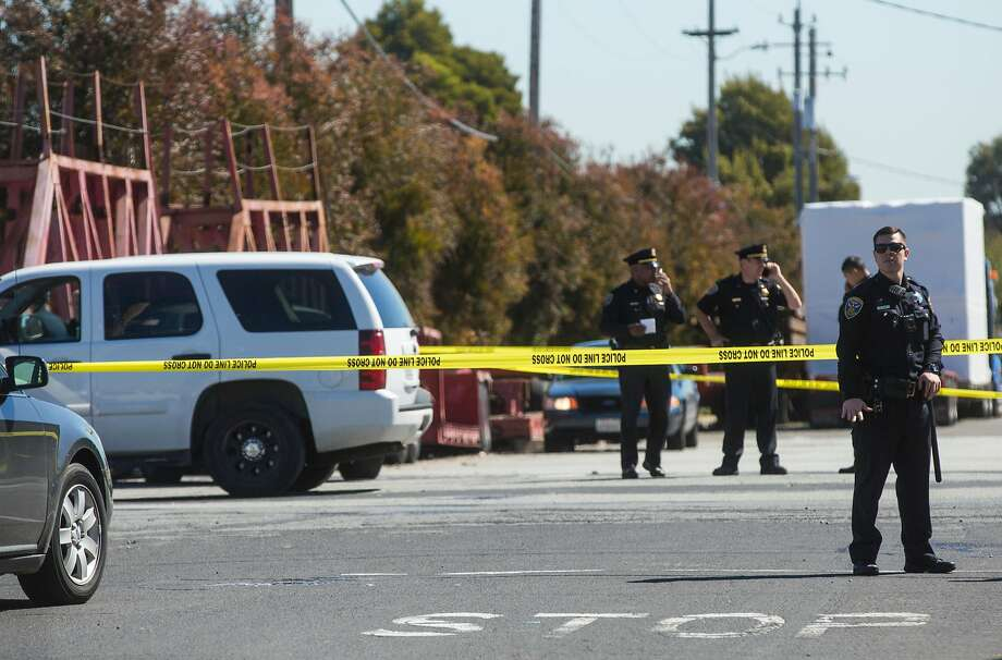 Officers on Wednesday are working the scene after a hit-and-run that left four injured and one dead near 24th and Illinois streets in San Francisco. Photo: Jessica Christian / The Chronicle