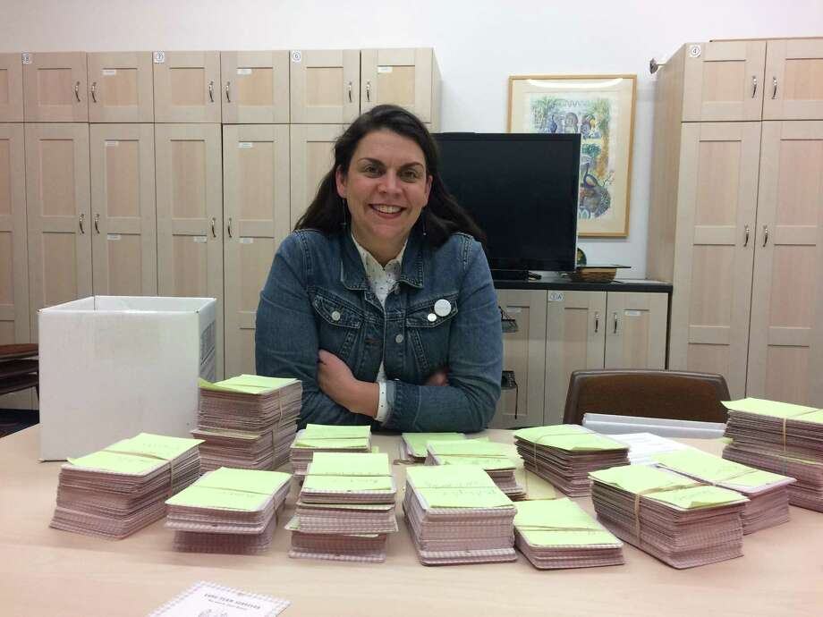 Kate Carey, head of education at the McNay Art Museum, sits with stacks of cards on which patrons shared survival stories during a retrospective of work by the late Chuck Ramirez. A reader commends the museum for this interactive approach. Photo: Deborah Martin /San Antonio Express-News /