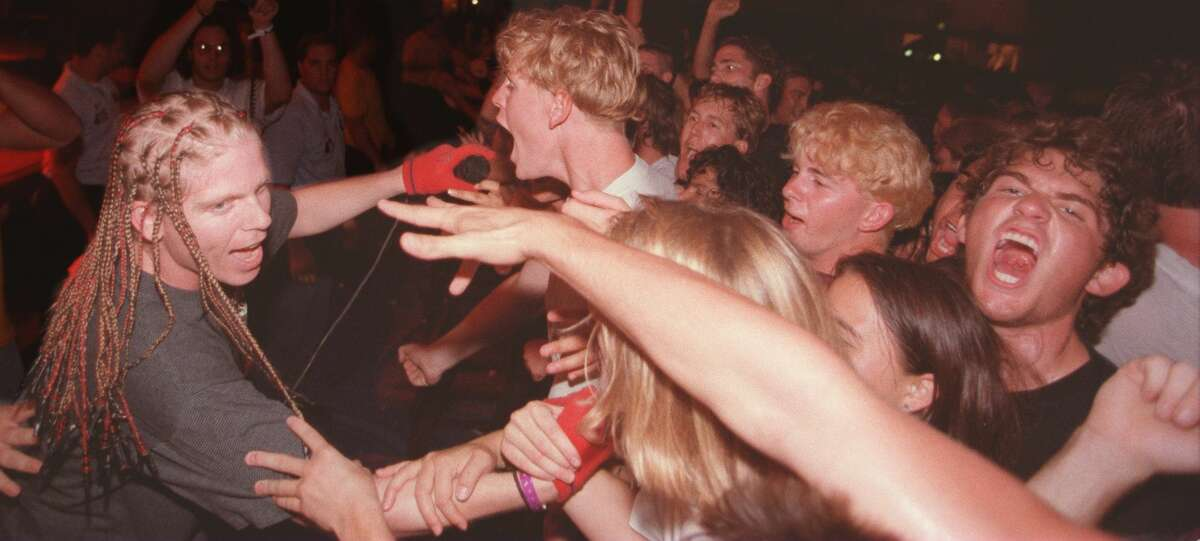An undated photo shows The Offspring singer Bryan Holland lets the crowd member sing-a-long at UC Irvine's Crawford Hall.