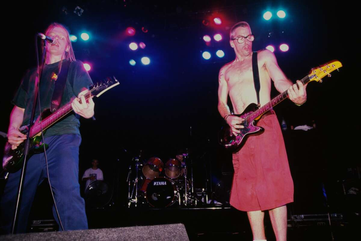 Singer/guitarists Dexter Holland (left) and Noodles (Kevin Wasserman) performing with American punk group The Offspring, London 1995.