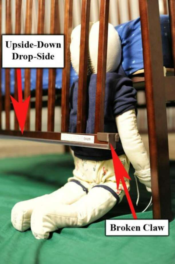 This U.S. Consumer Product Safety Commission photo shows how a child can become entrapped when a side panel from one of the 2.1 million recalled Stork Craft drop-side cribs detaches.