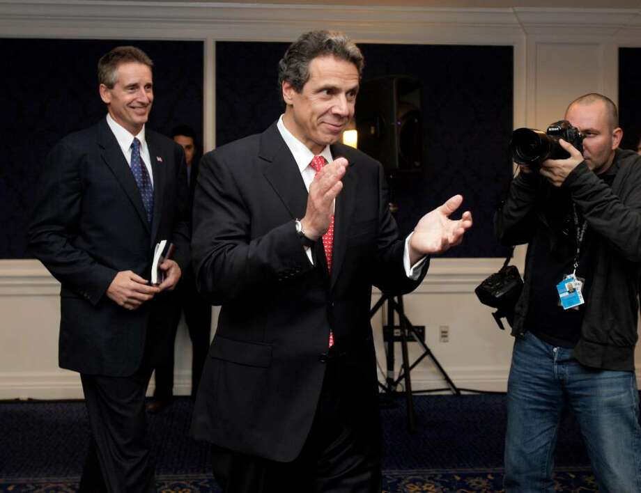Democratic candidate for governor Andrew Cuomo, center, precedes Rochester Mayor Robert Duffy, his choice for a running mate, as they arrive for a news conference in Manhattan. Duffy became mayor in 2006 after seven years as Rochester police chief. (AP Photo/Richard Drew) Photo: Richard Drew