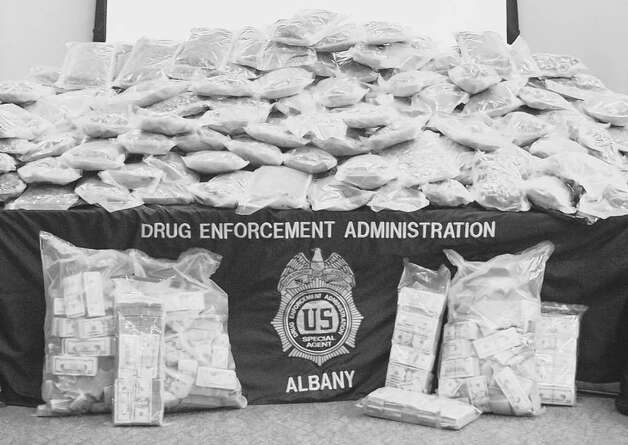 "Authorities said they seized nearly 400 pounds of pot from a truck driven by former mountain biking world champion Melissa ""Missy"" Giove and from Eric Canori's home outside Saratoga Springs in June. (File photo from U.S. Depatment of Justice)"