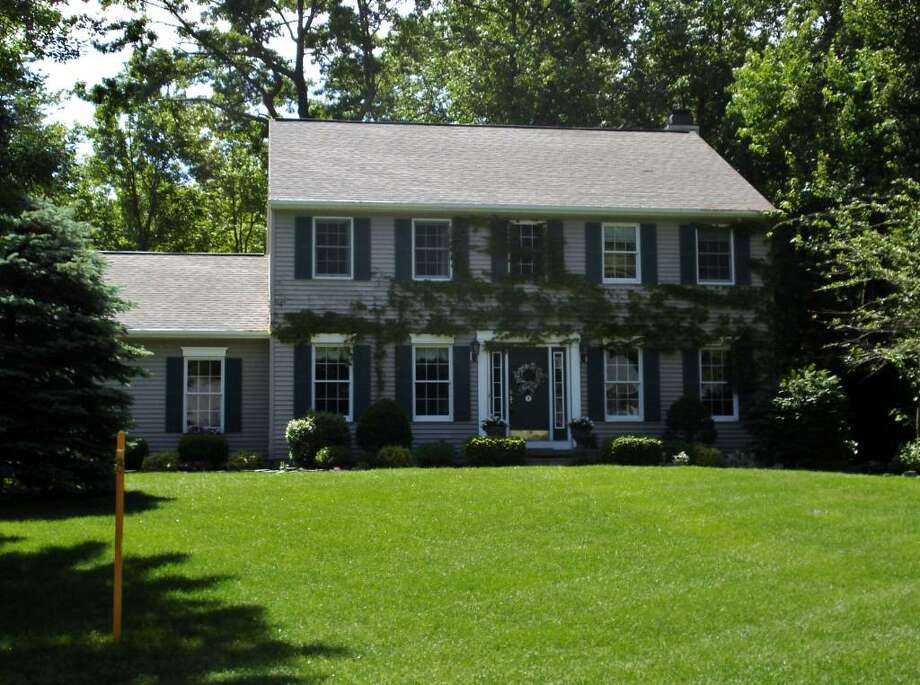 This 2,425-square-foot Colonial at 9 Dutchess Path in Halfmoon is on the market for $369,900. It has four bedrooms and 2.5 bathrooms. (Michael Lisi / Special to the Times Union)
