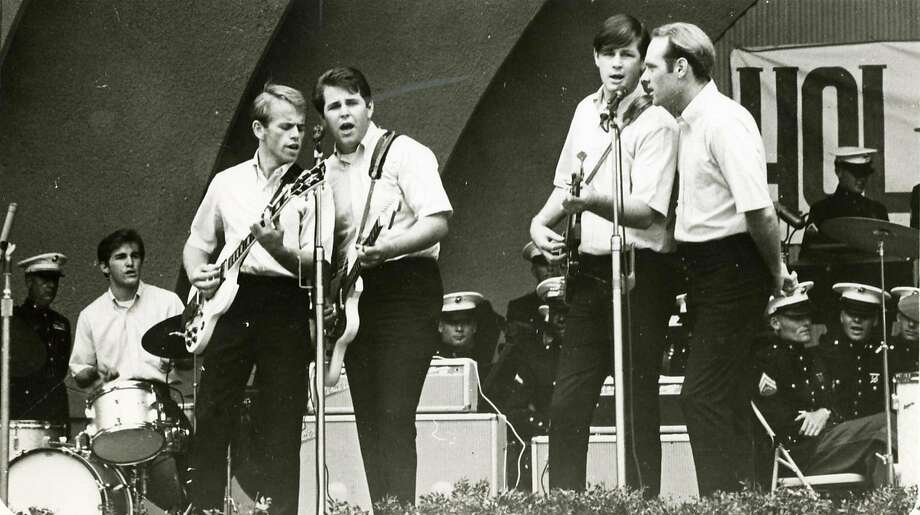 BEACH31_BOYS.JPG  THE BEACH BOYS play the Hollywood bowl on November 1, 1963.  Photograph by handout Photo taken on 5/27/05, in ,   Ran on: 05-31-2005 Rockers' roots: Surfers at Manhattan Beach, top left; Fosters Freeze, a Beach Boys hangout; and the neighborhood in Hawthorne where the Wilson family lived. Photo: Handout