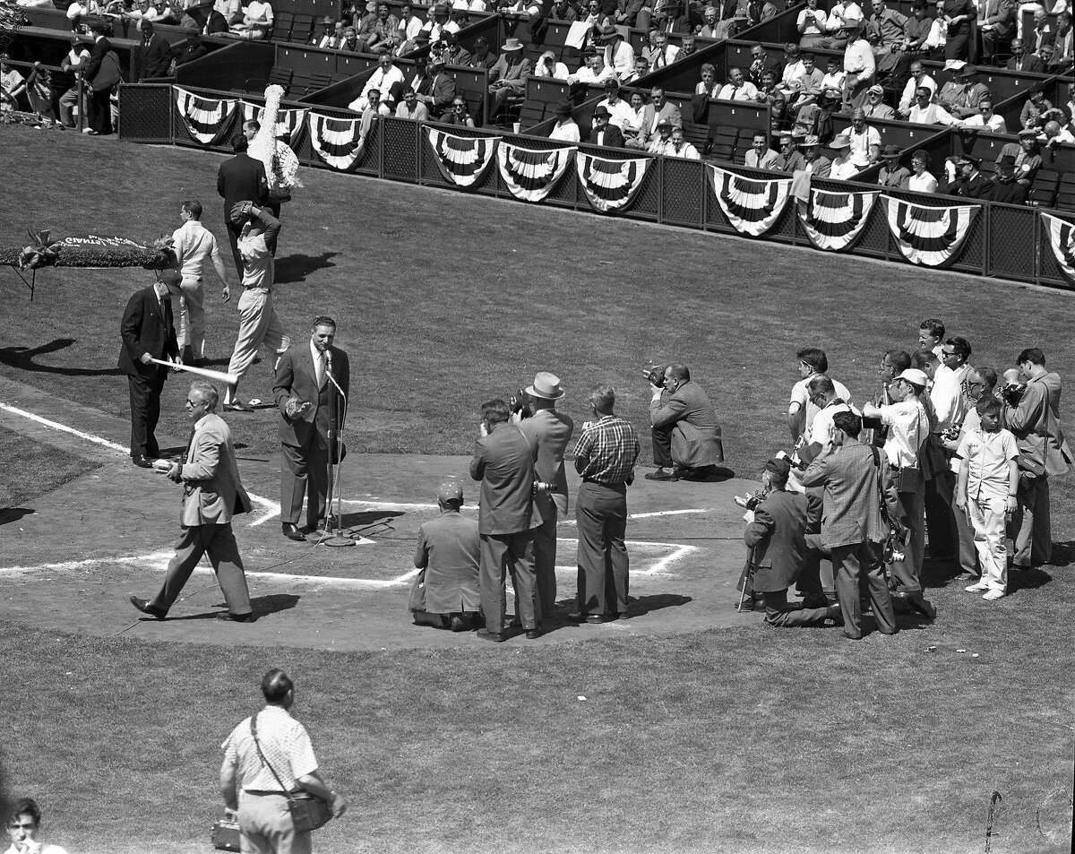 Mayor George Christopher speaks to the crowd at the Giants opening game against the Dodgers at Seals Stadium, April 15, 1958