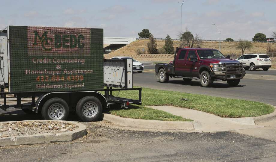 Portable electronic signs, on a small trailer, like the one shown 03/28/18 in the parking lot of Garfield Plaza, near Loop 250 and Garfield Street, have been seen around Midland. Tim Fischer/Reporter-Telegram Photo: Tim Fischer/Midland Reporter-Telegram