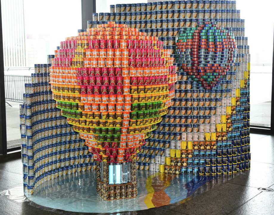 "The ""Up, Up and Away with Hunger"" scultpure incorporates 3,914 food cans. It is part of the CANstruction exhibit/fundraiser open at the State Museum in Albay through April 11. A dozen teams raised money to buy thousands of nonperishable food items to build the sculptures. After the exhibit closes, the food will be donated to local pantries. (Photo credit: Steve Barnes.)"