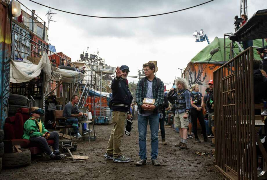"This cover image released by Warner Bros. Pictures shows director Steven Spielberg, left, and Tye Sheridan on the set of ""Ready Player One."" (Jaap Buitendijk/Warner Bros. Pictures via AP) Photo: Jaap Buitendijk / © 2017 Warner Bros. Entertainment Inc.,"
