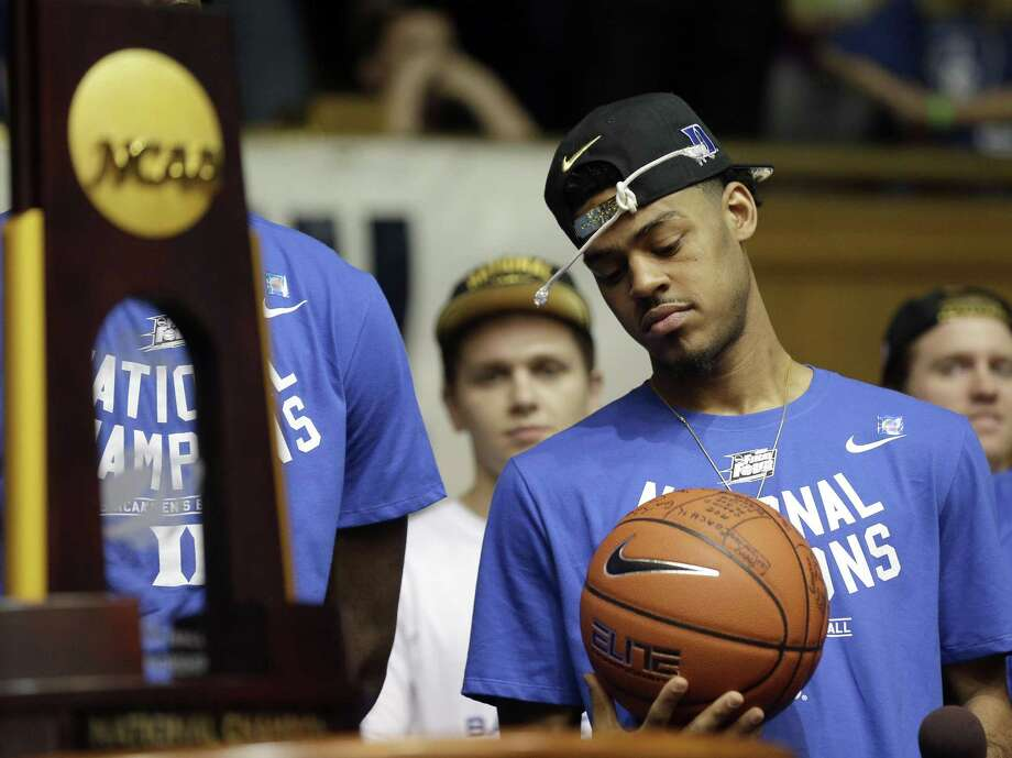 Duke's Quinn Cook holds a ball as members of the Duke basketball team are welcomed during a homecoming celebration at Cameron Indoor Stadium Tuesday, April 7, 2015 in Durham, N.C. Duke defeated Wisconsin Monday night in the NCAA Final Four tournament championship game. (AP Photo/Gerry Broome) Photo: Gerry Broome, STF / Associated Press / AP
