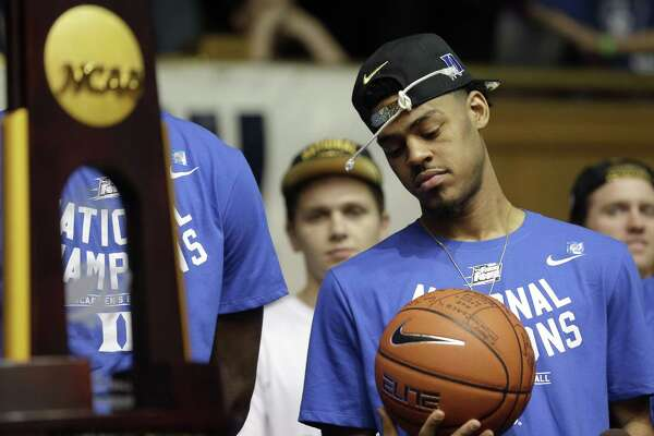 1of3Duke s Quinn Cook holds a ball as members of the Duke basketball team  are welcomed during a homecoming celebration at Cameron Indoor Stadium  Tuesday bce4ebfc6