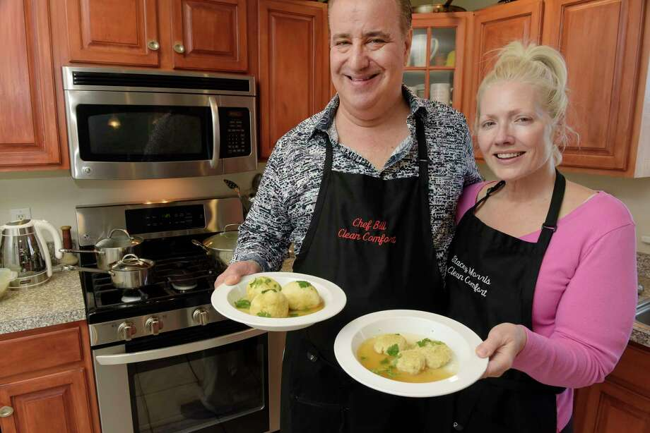 Chef Bill Duckman, left, and Stacey Morris hold plates with matzo balls at their home on Monday, March 26, 2018, in Loudonville, N.Y.   (Paul Buckowski/Times Union) Photo: PAUL BUCKOWSKI / (Paul Buckowski/Times Union)